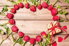 Frame of fresh roses with a gift box Royalty Free Stock Photography