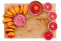 Frame of fresh ruby grapefruit halves Royalty Free Stock Photos