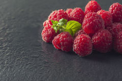 Frame of Fresh Sweet Raspberries with Water Drops on Black backg. Round, closeup. Selective focus Royalty Free Stock Image