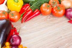 Frame of  fresh vegetables. Blank wooden table  with frame of  fresh colorful vegetables Royalty Free Stock Images