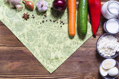 Frame of fresh vegetables and dairy products on wooden backgroun Royalty Free Stock Images