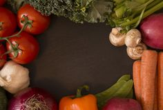 Frame of Fresh Vegetables. A Frame of Various Vegetables on a Chalkboard Slate Background royalty free stock photo