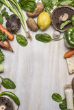 Frame of fresh vegetables, fruits,mushrooms and herbs on wooden rustic background top view close up Stock Images