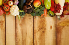 Frame of Fruits and Autumn Yield. Frame New Harvest Autumn Yield with Vegetables, Fruits, Mushrooms and Berries closeup on Wooden background stock photos