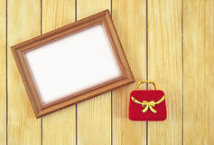 Frame and gift box on the background of  wooden laths Stock Photo