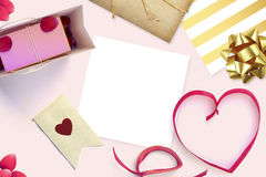 Frame with gift card and valentines heart. White card for congratulation on a background Stock Photography
