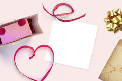 Frame with gift card and valentines heart. White card for congratulation on a background Royalty Free Stock Photos