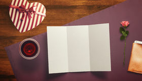 Frame with gift card and valentines heart. White card for congratulation on a background Stock Photos