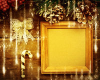 Frame with gifts on wooden background. Stock Photo