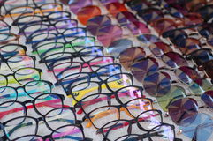 Frame glasses. Wide range of colourful frame glasses and sunglasses at a market Royalty Free Stock Images