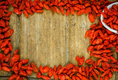 Frame of Goji berries on a wooden board. Stock Photo