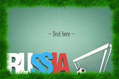 A frame of grass with the word russia and a soccer ball at the g Royalty Free Stock Photography