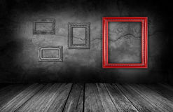 Frame on gray stone wall background in interior room. Red frame on gray stone wall background in interior room Royalty Free Stock Images