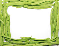 Frame of Green beans on white Royalty Free Stock Photos