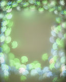 Frame with green and blue bokeh lights with flower shapes Stock Photo