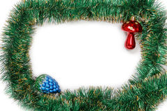 Frame of green Christmas garland with Christmas toys Royalty Free Stock Images