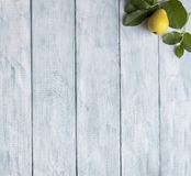 Frame of green leaves and a pears on wooden vintage boards. copy space stock images