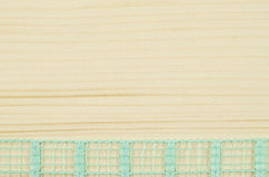 Frame of green ribbon on wooden background Royalty Free Stock Image