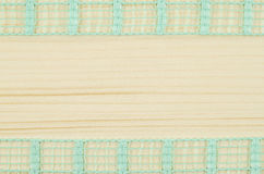 Frame of green ribbon on wooden background Stock Photo