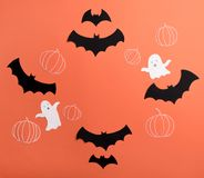 Frame of haloween symbols on red background for logo and text. Traditional haloween symbols of black bats, pumpkins and ghosts on red background. Haloween Stock Photography