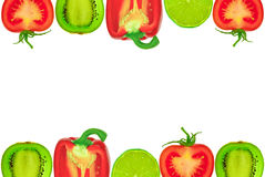 The frame of the halves of the fruit and vegetables on a white background Royalty Free Stock Image