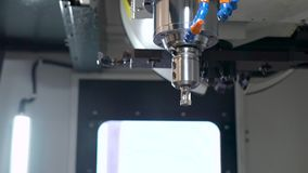 In the frame of the hand of the engineer and the mill for the CNC machine. stock footage