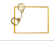 Frame with handcuffs. Frame made of wood designed to surround and contain items with handcuffs Stock Photography