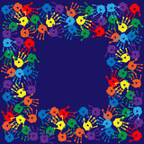Frame with handprints on  blue background Royalty Free Stock Image