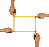 Frame of hands with measuring tapes Royalty Free Stock Image