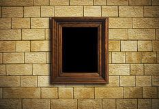 Frame hanging on brick wall Royalty Free Stock Images
