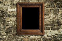 Frame hanging on brick wall Stock Image