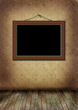 Frame hangs on an old wall. Royalty Free Stock Photo