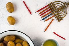 Frame of Hanukkah, olive oil and potatoes on a white background Royalty Free Stock Photography