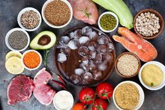 Frame of Healthy food Clean eating selection Including Certain Protein Prevents Cancer on a dark stone backgound Stock Photos