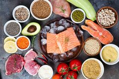 Frame of Healthy food Clean eating selection Including Certain Protein Prevents Cancer on a dark stone backgound Stock Image