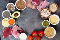 Frame of Healthy food Clean eating selection Including Certain Protein Prevents Cancer on a dark stone backgound Stock Photo