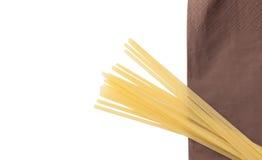 Frame of heap of italian macaroni spaghetti on brown napkin. Royalty Free Stock Image