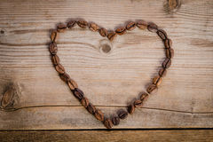 Frame- heart from coffee beans Stock Images