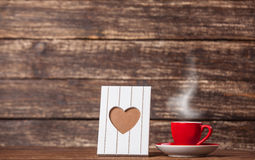 Frame with heart shape and cup Royalty Free Stock Photo