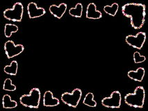 Frame of hearts. Beautiful frame of multi-colored hearts on a black background Royalty Free Stock Images