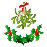 Frame of holly and a sprig of mistletoe. Traditional symbols of Christmas, a sprig of mistletoe with a red bow, holly Stock Photo