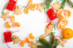 Frame of homemade christmas cookies, mandarines and gifts with c Stock Photo
