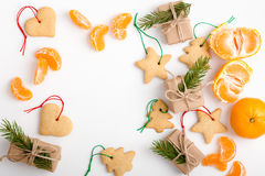 Frame of homemade christmas cookies, mandarines and gifts with c Royalty Free Stock Images