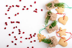 Frame of homemade christmas cookies, pomegranate seeds and gifts Stock Photography