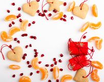 Frame of homemade christmas cookies, pomegranate seeds, mandarin Stock Photos