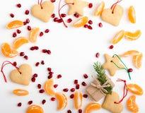 Frame of homemade christmas cookies, pomegranate seeds, mandarin Royalty Free Stock Image
