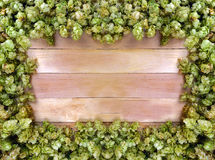 Frame of hop cones on wooden background. Ideas. Stock Photo