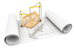 Frame House with Caliper and Hoisting Crane over Architect Bluep Stock Images