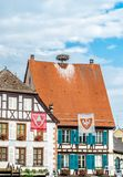 Frame House in Colmar, France. Frame house with storks nest on the roof in Colmar, France royalty free stock photos