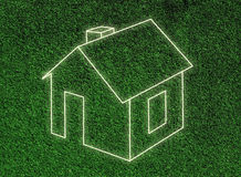 Frame of house illustration on grass Stock Image
